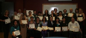 The graduates of NSIS's legal training course pose with the certificates in March 2011.